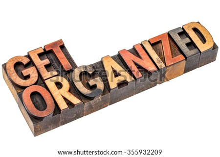 get organized  motivational phrase - isolated text in vintage letterpress wood type stained by color inks - stock photo