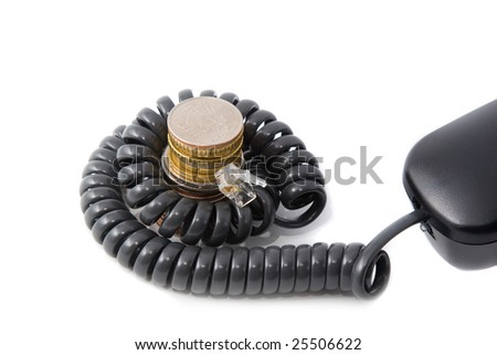 Get profit using telephone: cord spiral around coins stack - stock photo