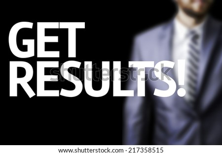 Get Results written on a board with a business man on background - stock photo