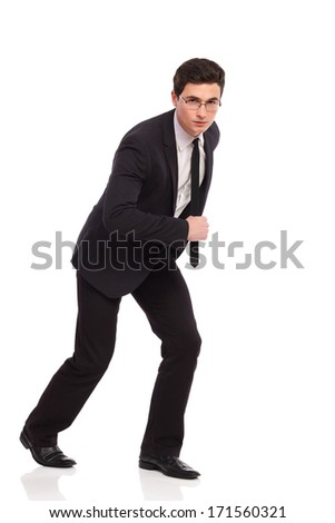 Get set ready go! Businessman ready to run. Full length studio shot isolated on white.