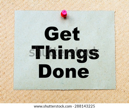 Get Things Done written on paper note pinned with red thumbtack on wooden board. Business conceptual Image - stock photo