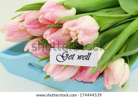 Get well card with pink tulips  - stock photo