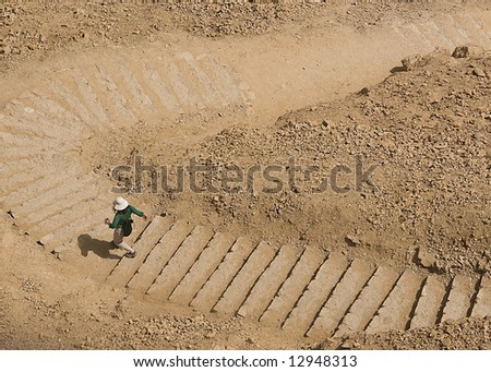 Getting down by foot from Masada - stock photo