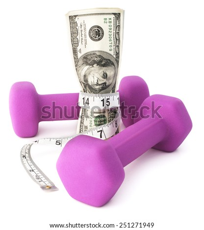 Getting fiscally fit. Dumbbells with a measuring tape and cash. - stock photo