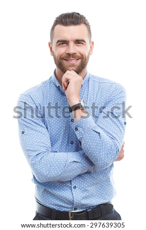 Getting idea. Smiling thoughtful handsome man standing on white isolated background and touching his chin with hand - stock photo