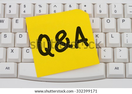 Getting Q&A online, Computer Keyboard with a yellow blank sticky note with text  Q&A - stock photo