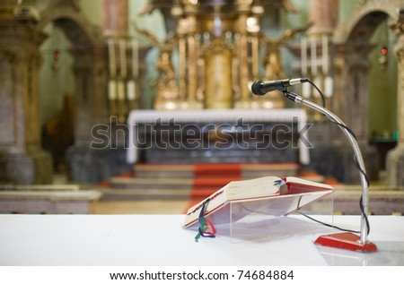 Getting ready for mass in a beautiful baroque church interior. - stock photo