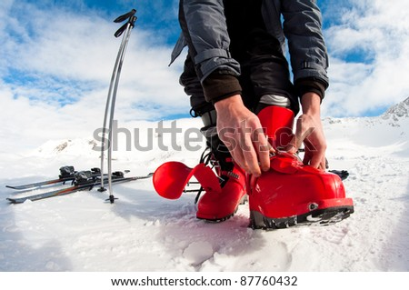 getting ready for skiing - fastening the boots - stock photo