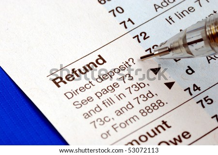 Getting refund from the income tax return isolated on blue - stock photo