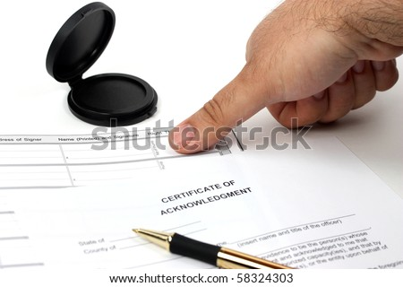 Getting thumb print for official record - stock photo
