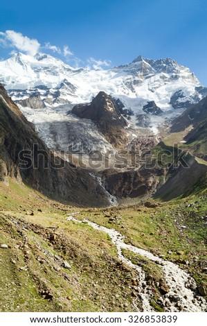 Getting warmer - the glacier stream in Himalayas (Zanskar, India) - stock photo