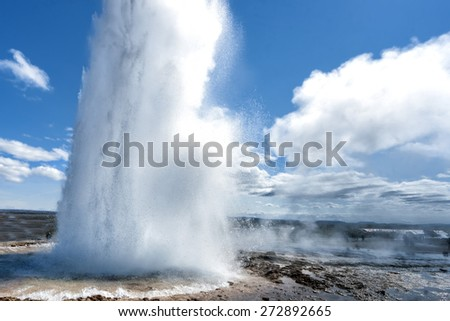 Geyser eruption in Iceland while blowing water  - stock photo