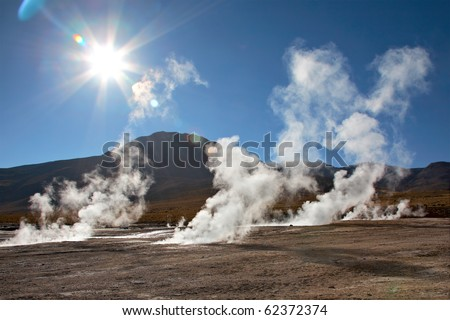 Geyser field El Tatio in back lighting, Atacama region, Chile - stock photo