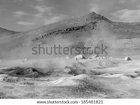 Geyser (geothermal area) Sol de Manana in Eduardo Avaroa National Reserve - Bolivia, South America (black and white) - stock photo