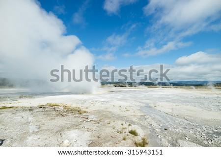 Geysers erupting in Yellowstone National Park beautiful landscape, Wyoming, US, America during Summer vacation - stock photo