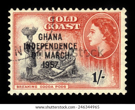 GHANA - CIRCA 1957: A stamp printed in Ghana shows cocoa processing and queen Elizabeth II, stamp of Gold Coast overprinted in black, Ghana Independence, circa 1957 - stock photo