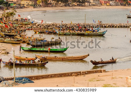 GHANA, ELMINA - MARCH 2, 2012: Boats on the Elmina coast selling stuff in Ghana, March 2, 2012. Coast of Elmina is the embarkation point to America