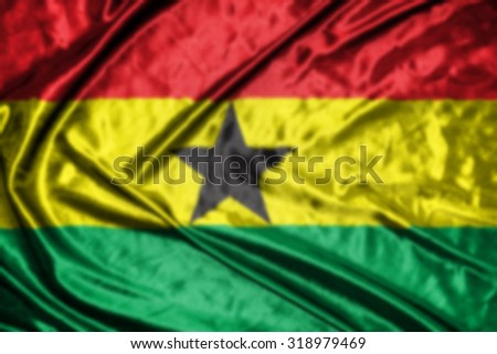ghana flag,abstract blurred background - stock photo