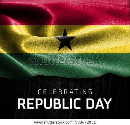 Ghana flag and Celebrating Republic Day Typography on wood background - stock photo
