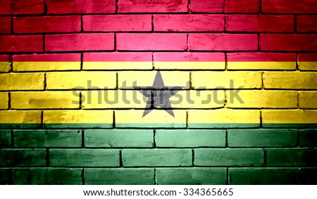 Ghana Flag on a brick wall background - stock photo