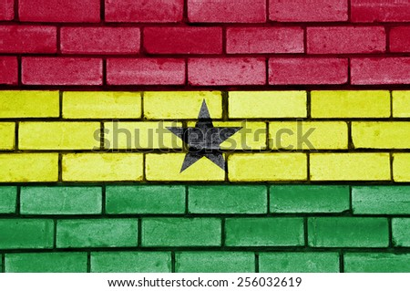Ghana flag painted on old brick wall texture background - stock photo