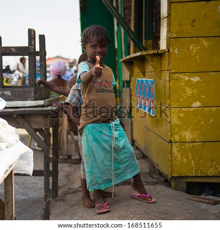 GHANA - MARCH 2, 2012: Portrait of a Unidentified Ghanaian little girl showing Ok in Ghana, on March 2nd, 2012. People in Ghana suffer from poverty due to the slow development of the country