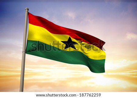 Ghana national flag against beautiful blue and yellow sky - stock photo