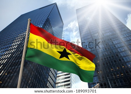 Ghana national flag against low angle view of skyscrapers - stock photo