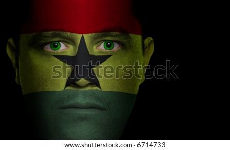 Ghanaian flag painted/projected onto a man's face