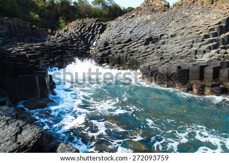 "Ghenh Da Dia (Ganh Da Dia), giant's basalt causeway. Tuy An District, Phu Yen Province, Vietnam/""Ghanh Da Dia"" - Basalt rocks causeway in Phu Yen, Vietnam - stock photo"