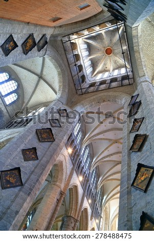 Ghent, Belgium - APR 12 2015: Gothic arches supported by tall pillars of the St Nicholas church