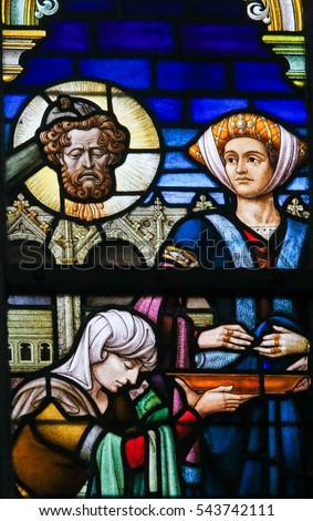 GHENT, BELGIUM - DECEMBER 23, 2016: Stained Glass depicting Salome with the Head of John the Baptist in the Cathedral of Saint Bavo in Ghent, Flanders, Belgium.