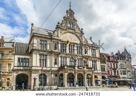 GHENT, BELGIUM - MAY 12, 2014: Tourists in city center of Ghent. Ghent is a city and a municipality located in the Flemish region of Belgium, capital and largest city of the East Flanders province.