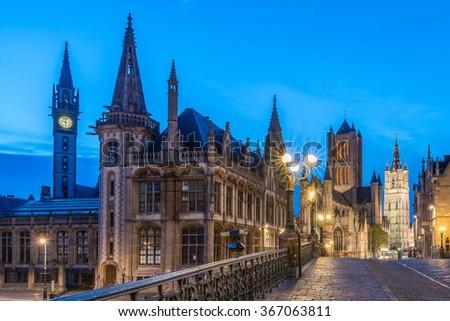 Ghent, Panoramic View of Graslei Korenlei Streets, Saint Bavo Cathedral, St Michael's Bridge, Saint Nicholas' Church, Korenmarkt (grain Market), Old Post Office, Clock Tower Landmark over Leie river - stock photo