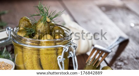 Gherkins with fresh dill in a glass