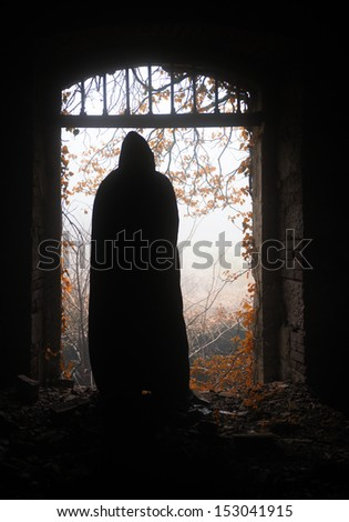 Ghost apparition through the gate - stock photo