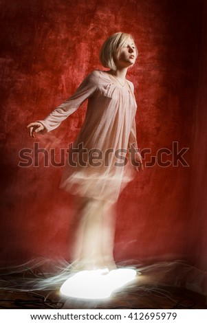 Ghost digital girl on red grunge wall