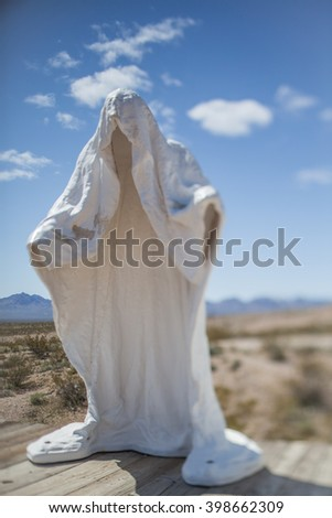 Ghost figure, Symbolic White Plaster Ghost Emblem of the Abandoned Miner's Ghost City Rhyolite in Nevada, USA - stock photo