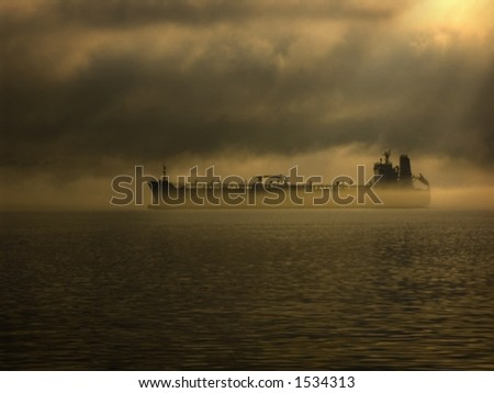 Ghost ship sailing out of the fog