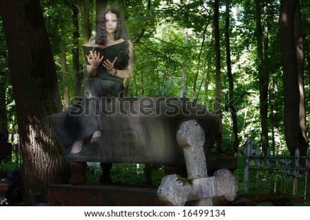 Ghost sitting on coffin reading book - stock photo