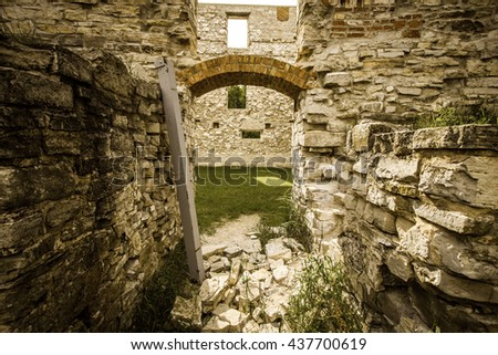 Ghost Town Ruins. Crumbling wall of an abandoned building in the ghost town of Michigan's Upper Peninsula. Fayette State Historical Park. Fayette, Michigan. - stock photo