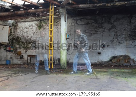ghost workers in abandoned factory - stock photo