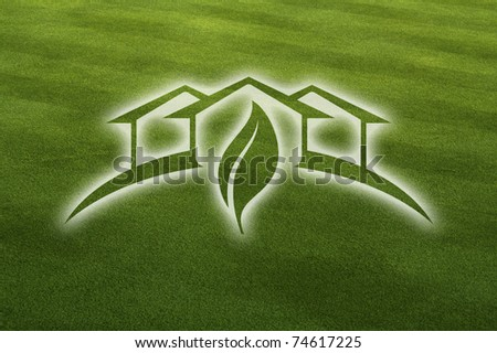 Ghosted Green House with Leaf Over Fresh Cut Grass Field. - stock photo