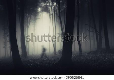 ghostly figure in dark spooky forest halloween scene - stock photo