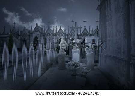 Ghosts walking in a street from an old cemetery at night