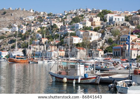 Gialos, the harbour of the island of Symi in the Dodecanese, southeast of Aegean Sea, Greece. - stock photo