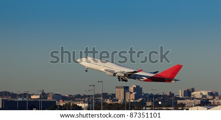 giant airplane departures sydney airport over city buildings take-off land - stock photo