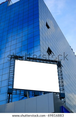 giant blank billboard, display on a skyscraper in a big city for advertising - stock photo
