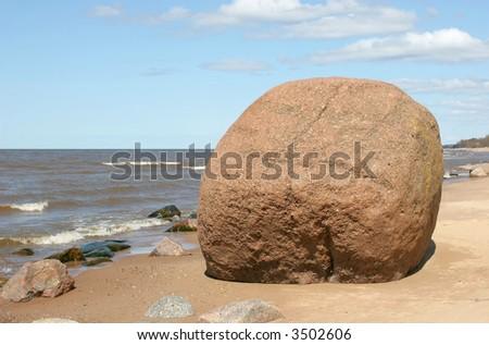 Giant boulder on the baltic sea coast (Latvia) - stock photo