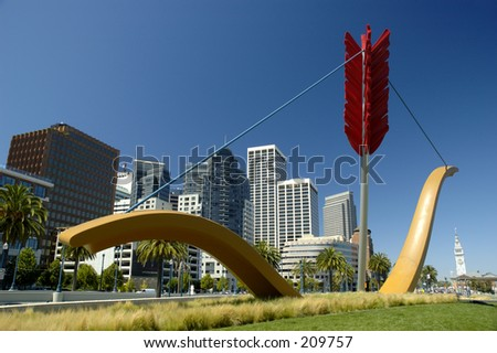 Giant bow and arrow in the middle of the city. - stock photo